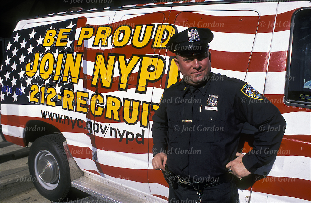 "NYPD Police Officer standing next to ""212-RECRUIT"" van, NYC"