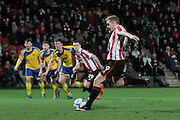 Danny Wright taking a penalty during the Vanarama National League match between Cheltenham Town and Altrincham at Whaddon Road, Cheltenham, England on 19 December 2015. Photo by Carl Hewlett.