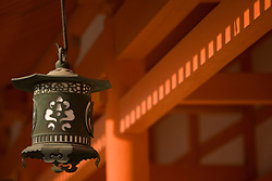 Asia, Japan, Honshu island, Kyoto, bronze lanterns and orange pillars of Heian Jingu Shrine, imperial Shinto shrine built in 1895