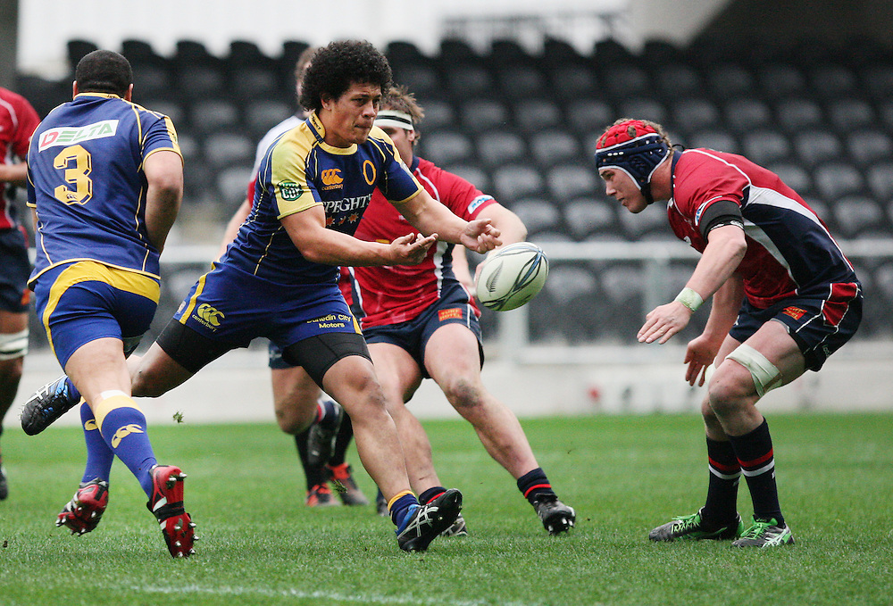 Otagos' TJ Loane gets the ball away against Tasman in the ITM rugby preseason match at Forsyth Barr Stadium, Dunedin, New Zealand, Sunday, August 12, 2012. Credit:SNPA / Dianne Manson