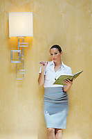 Business woman holding document in office,  portrait