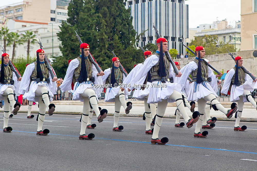 Evzones march during the Changing of the Guard ceremony in front of the Old Royal Palace in Syntagma Square, Athens. The official ceremony is held every Sunday at 11 AM.