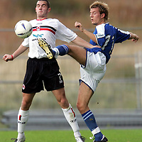 Clyde v St Johnstone...02.10.04<br />Gary Arbuckle is tackled by Lee Hardy<br /><br />Picture by Graeme Hart.<br />Copyright Perthshire Picture Agency<br />Tel: 01738 623350  Mobile: 07990 594431