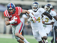 Ole Miss Rebels tight end Evan Engram (17) makes a catch and is tackled by Mississippi State Bulldogs linebacker Christian Holmes (44) at the Bulldog 1 yard line at Vaught-Hemingway Stadium in Oxford, Miss. on Saturday, November 29, 2014.