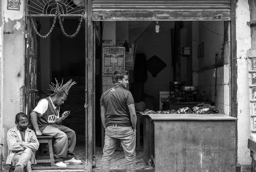 A butcher in Kathmandu, Nepal and his friends passing the time