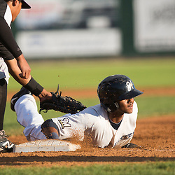 Carlos Belonis dives back to first base during a pick--off attempt in the fourth inning. Belonis would go on to steal second, and race to third on a throwing error.