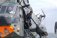 09 AUG 2001, OSTSEE/GERMANY:<br /> Gerhard Schroeder, SPD, Bundeskanzler, waehrend einem Besuch von Marineeinheiten im Seegebiet vor Rostock, hier nach der Landung mit einem SEA KING Hubschrauber (SAR Rettungshubschrauber) auf dem Tender DONAU<br /> IMAGE: 20010809-01-004<br /> KEYWORDS: Bundeswehr, Bundesmarine, Marine, Gerhard Schröder