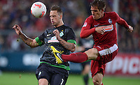 FUSSBALL   1. BUNDESLIGA   SAISON 2012/2013  5. SPIELTAG  26.09.2012 SC Freiburg - SV Werder Bremen Marko Arnautovic (li, SV Werder Bremen) gegen Oliver Sorg (SC Freiburg)