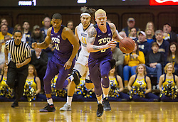 Jan 7, 2017; Morgantown, WV, USA; TCU Horned Frogs guard Jaylen Fisher (0) dribbles the ball up the floor during the first half against the West Virginia Mountaineers at WVU Coliseum. Mandatory Credit: Ben Queen-USA TODAY Sports