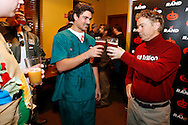 Gene Nassif, dressed as an Obamacare Surgeon (center), clinks drinks with Republican presidential candidate Rand Paul dressed in his $18 Trillion debt costumr after Nassif bought Paul a Confluence Des Moines IPA Friday, Oct. 30, 2015, during the Rand Paul Liberty Halloween Party at Buzzard Billy's in Des Moines.