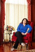 Portrait of lady in a red chair.<br /> <br /> Photographed by editorial and advertisement Texas photographer Nathan Lindstrom