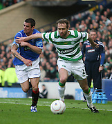 Andreas Hinkel holds off Nacho Novo during the League Cup final between Rangers and Celtic at Hampden Park -<br /> David Young
