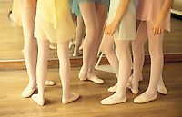 young ballet students' legs, at the Stanlowa school, Paris - Photograph by Owen Franken
