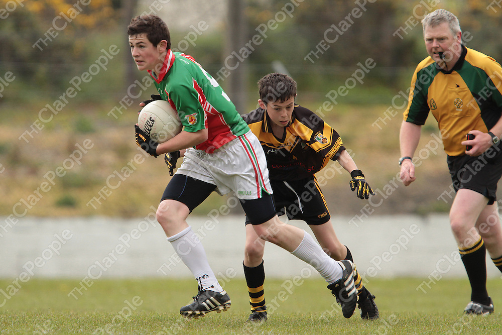 Eanna Barry Clooney/Quin gets by the challenge of Coolmeen/Kildysart's Mark Meaney in the Div 3 final replay.  Photograph by Flann Howard