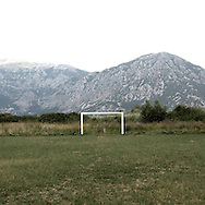 A football goal near Perast.There are several arguments about the derivation of the name  &quot;Montenegro&quot;, one of these relates to dark and deep forests  that once covered the Dinaric Alps, as it was possible to see them from the sea. <br /> Mostly mountainous with 672180 habitants on an area of 13812 Km&sup2;, with a population density of  48 habitants/Km&sup2;. <br /> It borders with Bosnia, Serbia, Croatia, Kosovo and Albania but  Montenegro has always been alien to the bloody political events that characterized Eastern Europe in recent decades. <br /> From 3 June 2006, breaking away from Serbia, Montenegro became an independent state. <br /> In the balance between economy devoted to sheep farming and a shy tourist, mostly coming from Bosnia and Herzegovina, Montenegro looks to Europe with a largely unspoiled natural beauty. <br /> Several cities in Montenegro, as well as the park Durmitor, considered World Heritage by UNESCO but not yet officially because Montenegro has yet to ratify the World Heritage Convention of UNESCO.