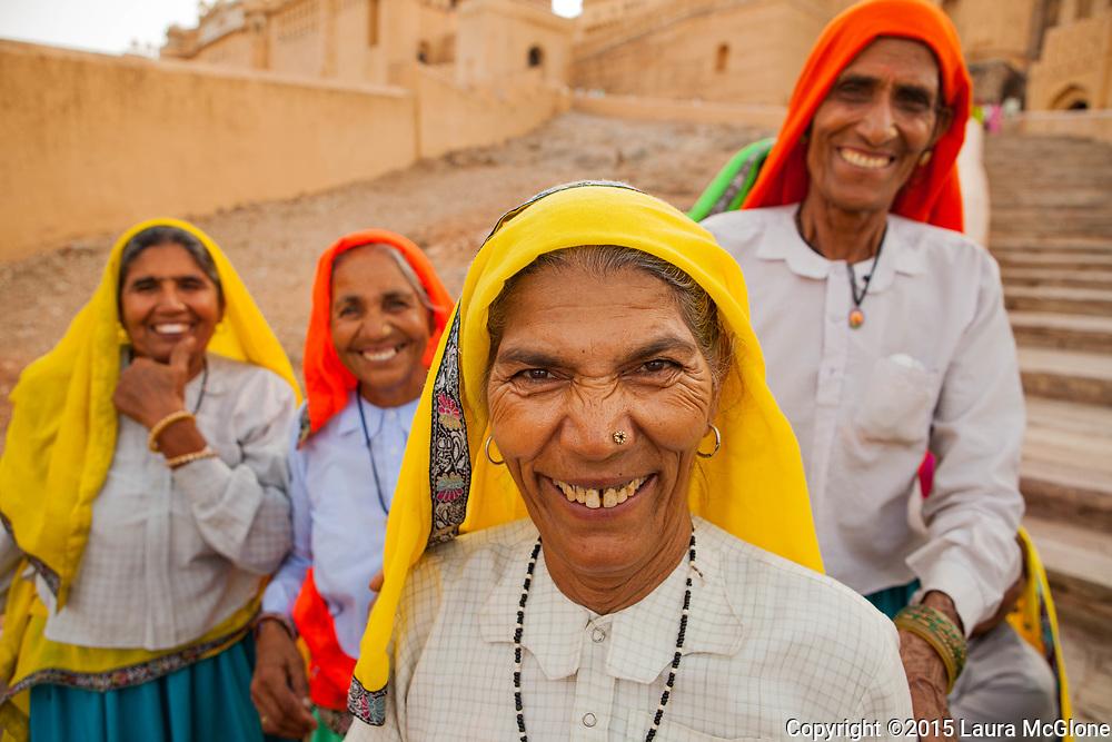 India - Jaipur Fort Rajasthan Smiling Ladies in Orange & Yellow