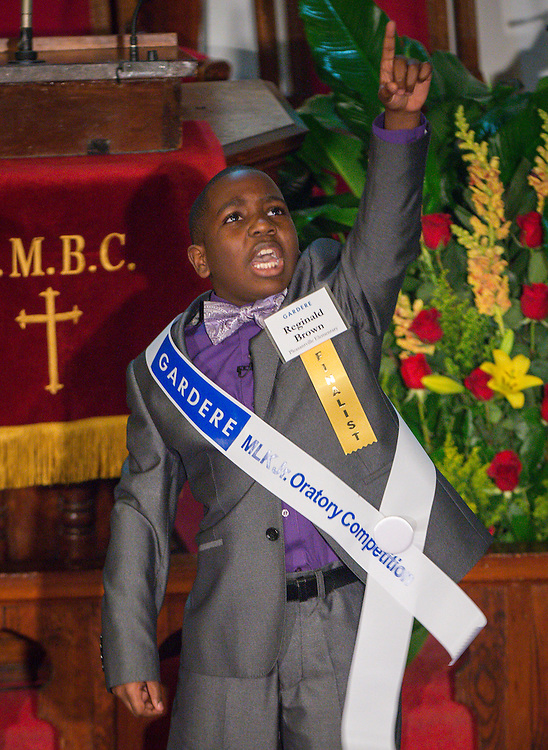 Reginald Brown of Pleasantville Elementary School performs during the Martin Luther King, Jr. Oratory Competition at Antioch Missionary Baptist Church, January 17, 2014.