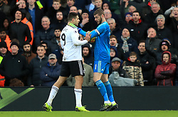 Manchester United goalkeeper David de Gea (right) grabs Fulham's Aleksandar Mitrovic by the throat