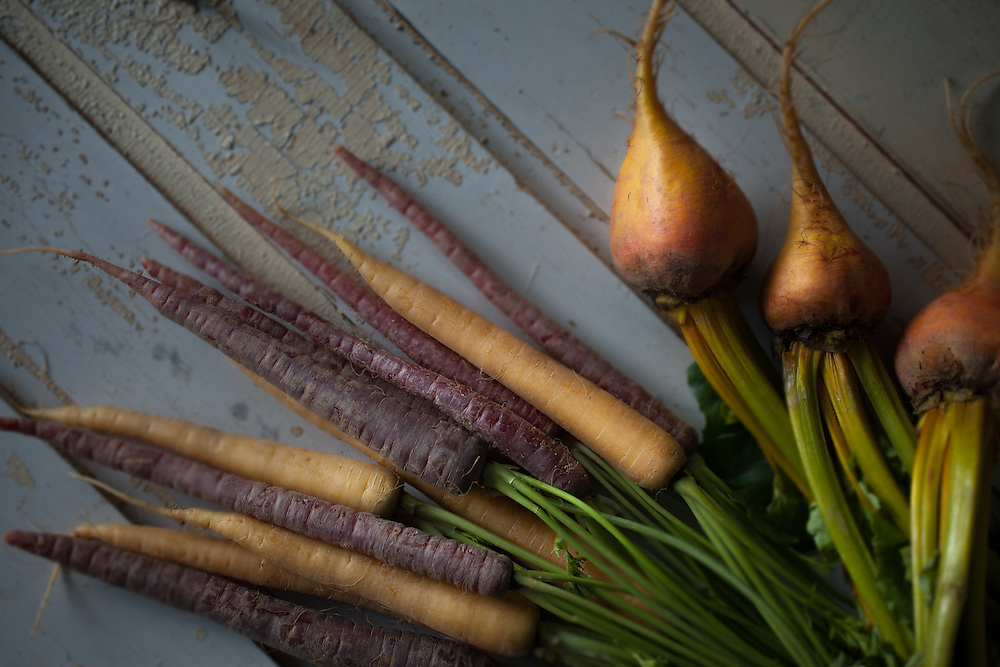 Captured these beautiful colors of beets and carrots using natural light. The bluish light as well as the pastel blue rustic door made the perfect combination to bring out the highlights