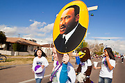 16 JANUARY 2012 - MESA, AZ: People carry pictures of Dr. Martin Luther King Jr. in the parade on Martin Luther King Day in Mesa, AZ, Monday, Jan. 16. Hundreds of people participated in the parade which marched through downtown Mesa.   PHOTO BY JACK KURTZ