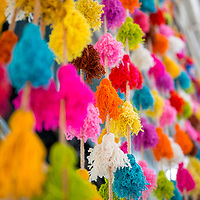 Cords of brightly colored yarn tassels on display at the Indian Market in the Miraflores neighborhood of Lima, Peru.