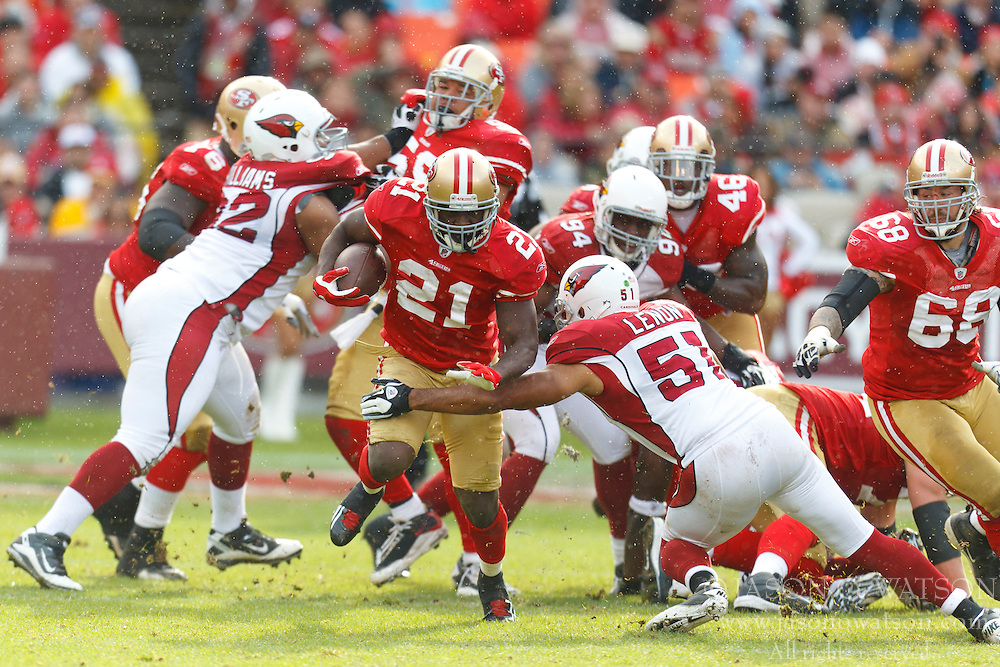 Nov 20, 2011; San Francisco, CA, USA; San Francisco 49ers running back Frank Gore (21) rushes past Arizona Cardinals inside linebacker Paris Lenon (51) during the second quarter at Candlestick Park. San Francisco defeated Arizona 23-7. Mandatory Credit: Jason O. Watson-US PRESSWIRE
