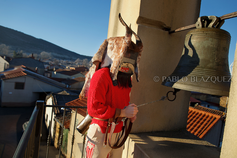 A man dressed as El Diablo (the devil) ring the bell of the church during La Filandorra festival on December 26, 2016 in the small village Ferreras de Arriba, Zamora province, Spain.  La Filandorra festival is a pagan winter masquerade that takes place during Saint Esteban festivities. The parade is represented by four characters, La Filandorra, El Diablo (Devil), La Madama (madame) y El Galán (Gallant). (© Pablo Blazquez)