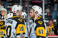 REGINA, SK - MAY 25: Nicholas Caamano #10 and Riley Stillman #61 of Hamilton Bulldogs react to the end of the season with the loss against the Regina Pats at the Brandt Centre on May 25, 2018 in Regina, Canada. (Photo by Marissa Baecker/CHL Images)