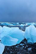 Jokulsarlon glacial lagoon by Vatnajokull National Park. Floating icebergs in blue water from Breioamerkurjokull Glacier, part of Vatnajokull Glacier in South East Iceland to the Atlantic Ocean