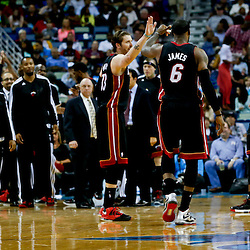 Mar 29, 2013; New Orleans, LA, USA; Miami Heat small forward LeBron James (6) celebrates with teammates during the second half of a game against the New Orleans Hornets at the New Orleans Arena. The Heat defeated the Hornets 108-89. Mandatory Credit: Derick E. Hingle-USA TODAY Sports