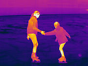 Thermogram of two ice skaters.  The different colors represent different temperatures on the object. The lightest colors are the hottest temperatures, while the darker colors represent a cooler temperature.  Thermography uses special cameras that can detect light in the far-infrared range of the electromagnetic spectrum (900?14,000 nanometers or 0.9?14 µm) and creates an  image of the objects temperature..