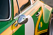 Image of outside rear view mirror on a 1972 Porsche 911T/ST Kremer Recreation in California, property released