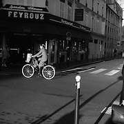 Early morning activity on the street corner of rue Juge and rue de Lourmel near Dupleix Station in  Paris, France. 28th February 2011. Photo Tim Clayton