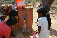Distributing Sawyer water filters in Torrecillo, Santa Cruz, Bolivia