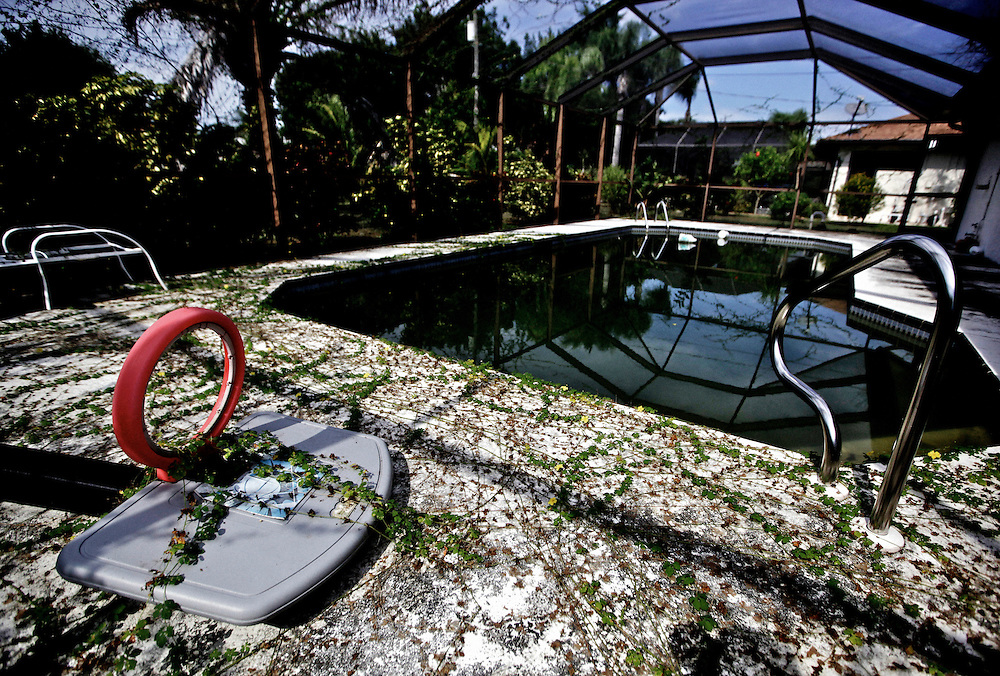 A foreclosed home soon to be auctioned is reclaimed by nature in Cape Coral. Greg Kahn/Staff