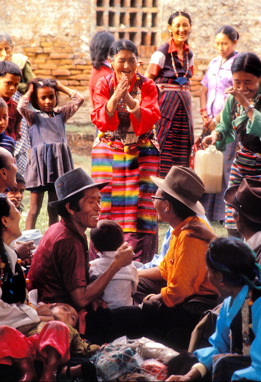 Tibetan exiles in Nepal celebrate the Dali Lama's birthday with chang -- a rice beer -- from a plastic jug in the village of Kimtole, below the hilltop Swyambhunath temple near Kathmandu