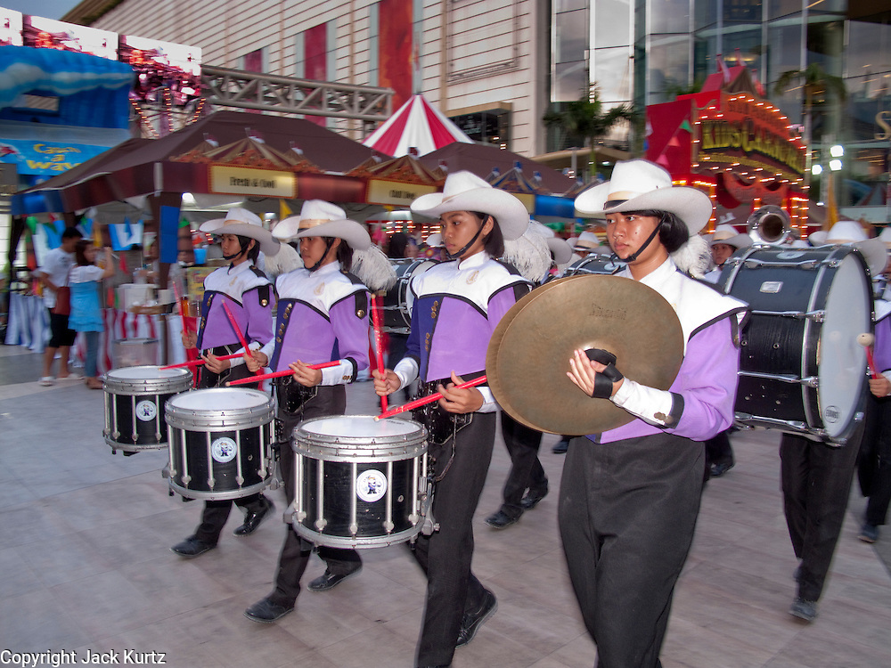 "04 OCTOBER 2009 -- BANGKOK, THAILAND: A Thai high school marching band performs during the ""Kid's Carnival"" in front of the Siam Center in Bangkok, Thailand.   PHOTO BY JACK KURTZ"
