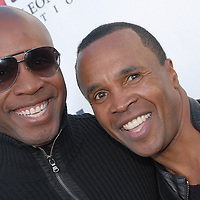 Major League Baseball Player Barry Bonds and Former Welterweight and Middleweight boxing champion Sugar Ray Leonard pose for photos on the red carpet  during ``Big Fighters, Big Cause'' charity boxing event at the Santa Monica Pier on Tuesday, May 25, 2010