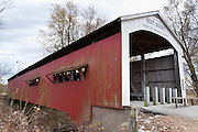 "Neet Covered Bridge (126 feet long), built in 1904 by J.J. Daniels over Little Raccoon Creek, on Bridgeton Road, Parke County, Indiana, USA. Red and white paint protects the wood. The traditional ""Cross this bridge at a walk"" sign required slow vehicle speed, but auto traffic is now diverted to an adjacent crossing."