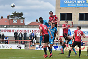 Morecambe Midfielder,  Alex Kenyon (4) heads during the EFL Sky Bet League 2 match between Morecambe and Barnet at the Globe Arena, Morecambe, England on 28 April 2018. Picture by Mark Pollitt.