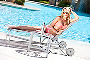 Sexy Blonde Female Lounging At The Pool