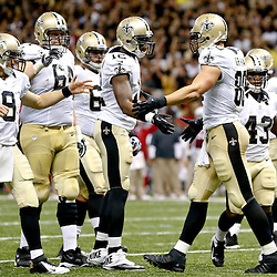 Sep 22, 2013; New Orleans, LA, USA; New Orleans Saints tight end Jimmy Graham (80) celebrates with teammates during a game against the Arizona Cardinals at Mercedes-Benz Superdome. The Saints defeated the Cardinals 31-7. Mandatory Credit: Derick E. Hingle-USA TODAY Sports
