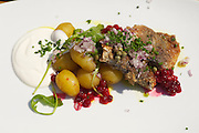 Kåseberga. Vendel Ales Stenar restaurant - Grill by the Sea. Fried herring with sour cream, lingonberries and new potatoes.