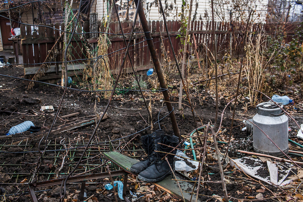 PIKSY, UKRAINE - NOVEMBER 19, 2014: Combat boots sit on a bench outside a house used by members of the Dnipro-1 brigade, a pro-Ukraine militia, in Pisky, Ukraine. The village of Pisky is the scene of much of the front-line fighting over the Donetsk airport. CREDIT: Brendan Hoffman for The New York Times