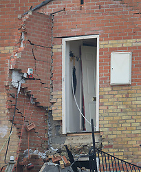 © Licensed to London News Pictures. 15/02/2017. Oxford, UK.  An umbrella can be seen still hanging in the hallway of the third floor in the remains of a block of flats damaged in an explosion near Osney Lock in Oxford. A number of people have been injured in what is thought to have been a gas explosion. Photo credit: Peter Macdiarmid/LNP