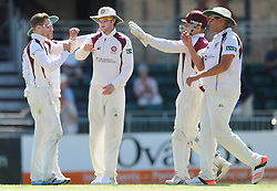 Northampton celebrate as Craig Miles of Gloucestershire is caught by Rory Kleinveldt of Northamptonshire bowled by White - Photo mandatory by-line: Dougie Allward/JMP - Mobile: 07966 386802 - 09/07/2015 - SPORT - Cricket - Cheltenham - Cheltenham College - LV=County Championship 2
