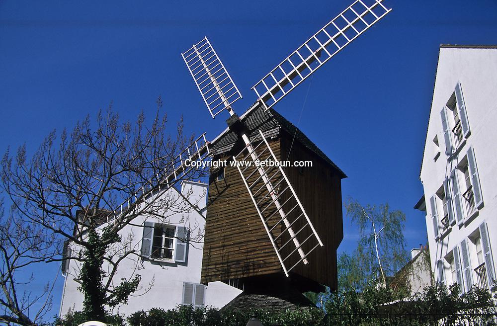 = Radet windmill in the Moulin de la galette parc Montmartre hill ,   Paris  France    +