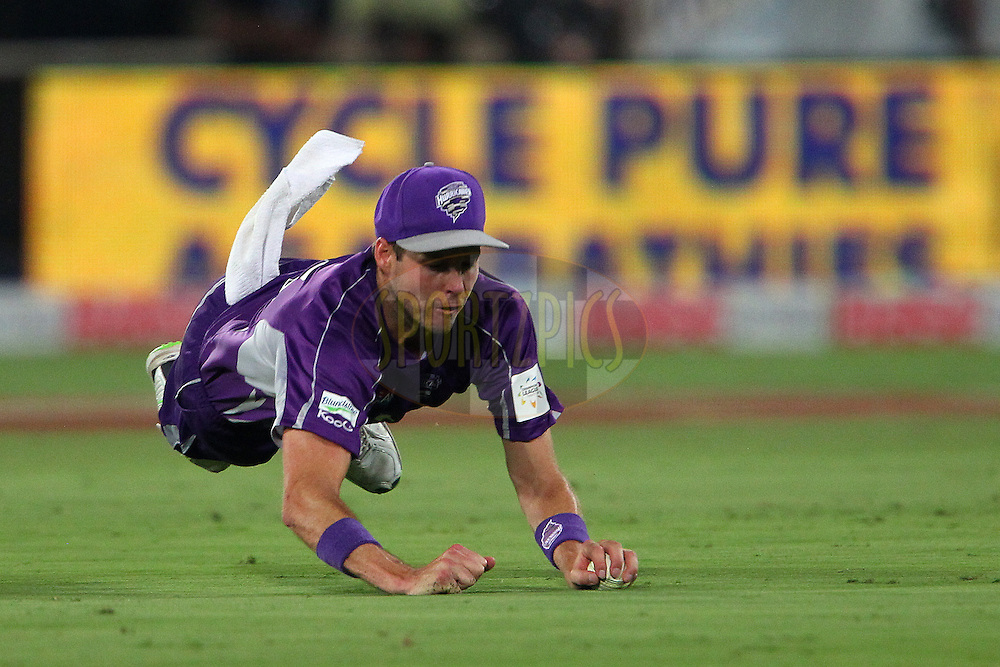 Ben LAUGHLIN of the Hobart Hurricanes dives for the ball in the field during the first semi final match of the Oppo Champions League Twenty20 between the Kolkata Knight Riders and the Hobart Hurricanes held at the Rajiv Gandhi Cricket Stadium, Hyderabad, India on the 2nd October 2014<br /> <br /> Photo by:  Ron Gaunt / Sportzpics/ CLT20<br /> <br /> <br /> Image use is subject to the terms and conditions as laid out by the BCCI/ CLT20.  The terms and conditions can be downloaded here:<br /> <br /> http://sportzpics.photoshelter.com/gallery/CLT20-Image-Terms-and-Conditions-2014/G0000IfNJn535VPU/C0000QhhKadWcjYs