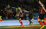 AFC Bournemouth defender Adam Smith celebrates the first goal during the Sky Bet Championship match between Brighton and Hove Albion and Bournemouth at the American Express Community Stadium, Brighton and Hove, England on 10 April 2015. Photo by Phil Duncan.
