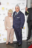 LONDON - May 14: Barbara Windsor & Mitch Winehouse at the Aston Martin Tailoring Collection - VIP Launch (Photo by Brett D. Cove)